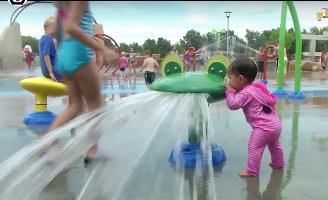 image of a kid at the Arvada Park water area
