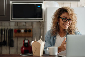 Person Eating While Attending Virtual Happy Hour